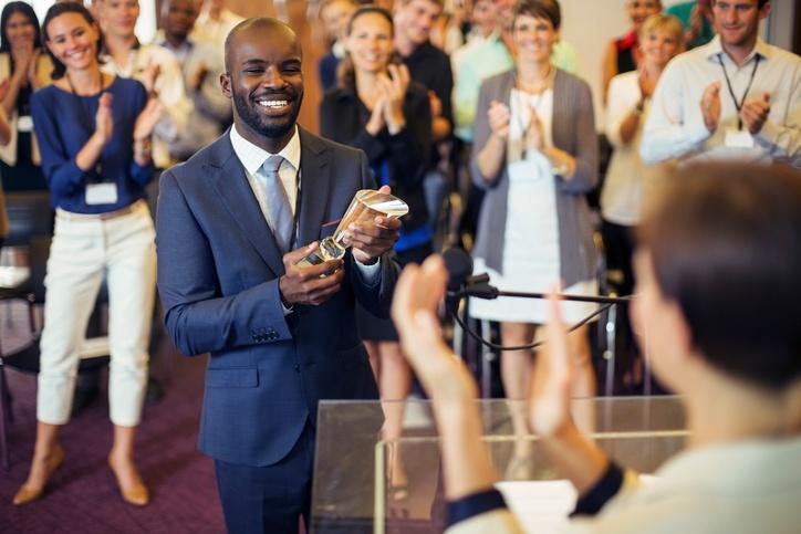 Man Receiving Business Award.jpg