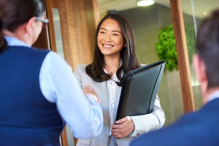 Young Woman Shaking Hands at Interview.jpg