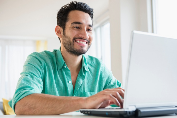 man completing online degree