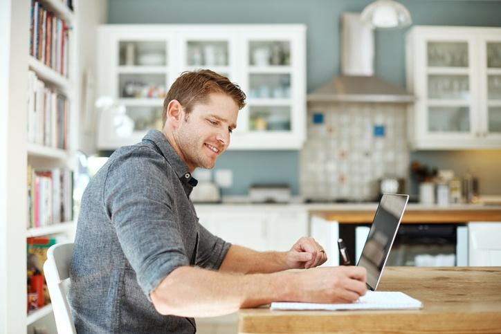 man studying using laptop at home