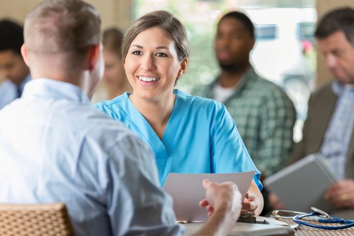 nurse interviewing at hiring event