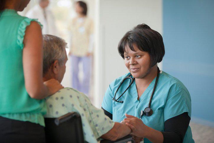 nurse listening to patient